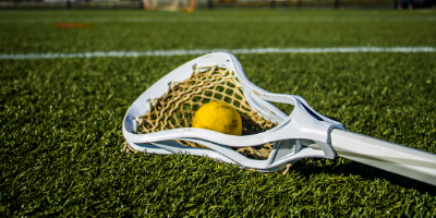 Lacrosse stick laying on the field