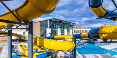 Waterslides, pool and building exterior