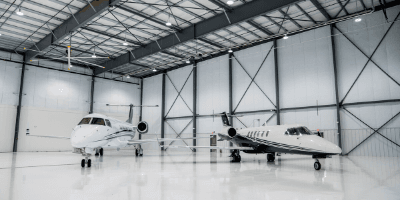 two airplanes in a hanger